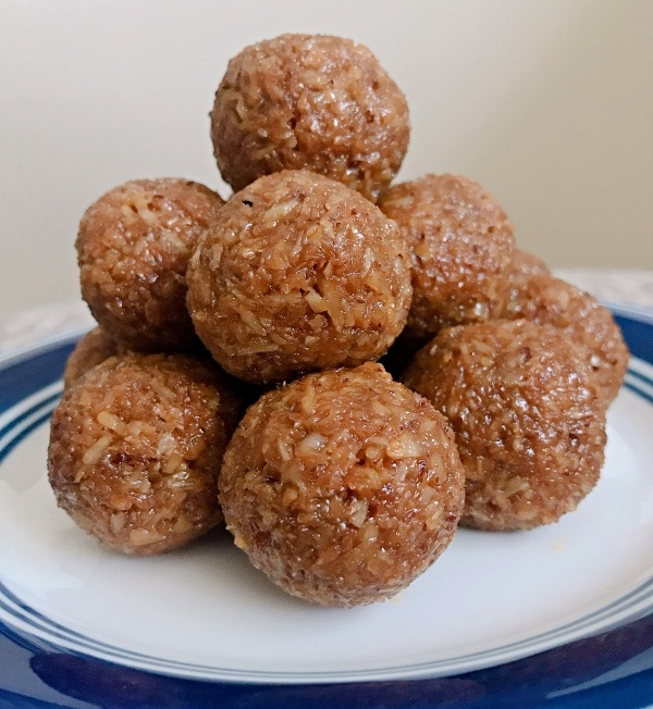 Coconut Ladoos Stacked on a plate