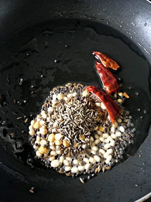 frying mustard seeds, cumin seeds, urad dal and red chilies