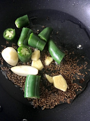 Saute chilies, cumin, garlic and ginger